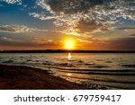 Sun Setting At A Lake In...