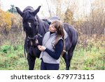 Small photo of Girl and horse in an autumn day