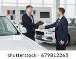 mature businessman buying a new ... | Shutterstock . vector #679812265