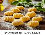 fresh homemade uncooked gnocchi ... | Shutterstock . vector #679853335
