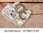 cash  narcotics  handcuffs  top ... | Shutterstock . vector #679857139
