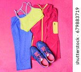 Small photo of Gym outfit workout clothes on exercise yoga mat. Fitness clothing, running shoes, leggings, sports bra, top, for working out. Fashion activewear.