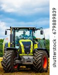 Small photo of Vinnitsa, Ukraine - July 2017: Agricultural tractor. Agricultural machinery CLAAS is ready before harvesting.