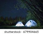 camping tents illuminated at...   Shutterstock . vector #679904665
