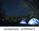 camping tents illuminated at... | Shutterstock . vector #679904671