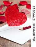 envelope with pen and heart - stock photo
