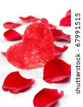 a red heart with rose petals - stock photo