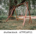 a wooden swing in the park. eco ... | Shutterstock . vector #679916911