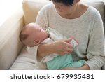 asian grandmother and her... | Shutterstock . vector #679935481