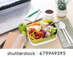 close up green lunch box on...   Shutterstock . vector #679949395