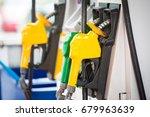 petrol pump filling nozzles at... | Shutterstock . vector #679963639