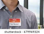 Small photo of A man with a name tag indicating the role he plays used to illustrate management concept