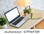 laptop computer on wood desk... | Shutterstock . vector #679969789