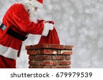closeup of santa claus placing... | Shutterstock . vector #679979539