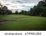 golf course surrounded by... | Shutterstock . vector #679981384