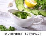 delicious yogurt sauce in gravy ... | Shutterstock . vector #679984174