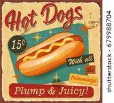 vintage hot dogs metal sign.    Shutterstock .eps vector #679988704