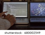 Small photo of Computer scientist pointing at code screen with algorithmic data