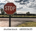 stop sign with cloud sky | Shutterstock . vector #680003635