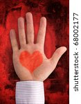 love concept. hand with heart shape on dark red background - stock photo