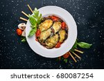 baked eggplant with parmesan... | Shutterstock . vector #680087254