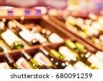 blurred racks with bottles of... | Shutterstock . vector #680091259