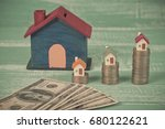 mini house on coin stack or... | Shutterstock . vector #680122621