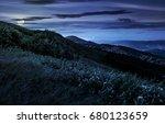 grassy meadow on a hillside at... | Shutterstock . vector #680123659