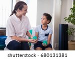 smiling female therapist... | Shutterstock . vector #680131381