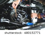 close up hands checking lube... | Shutterstock . vector #680152771