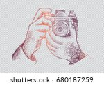 Two Hands Holding A Camera....