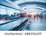 moving escalator in airport... | Shutterstock . vector #680196139