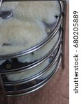 Small photo of Steamed idlis in idli maker