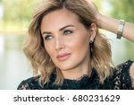 beautiful middle aged woman... | Shutterstock . vector #680231629