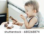 the child greedily eating... | Shutterstock . vector #680268874
