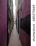 Small photo of Long and very narrow alleyway in an urban environment. Selective focus
