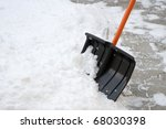 Using Snow Shovel On A Backyard