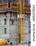 concrete bucket hanging on... | Shutterstock . vector #680325061