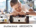 adorable kid fixing wires in... | Shutterstock . vector #680334574
