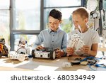 adorable little boys examining... | Shutterstock . vector #680334949