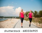 Two Women Running On The Beach...