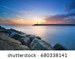 sunrise behind lighthouse at...   Shutterstock . vector #680338141