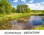 shallow flowing kinnickinnic... | Shutterstock . vector #680347099