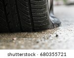 flat tire car in rainy day on... | Shutterstock . vector #680355721