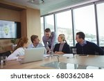 business people discussing at... | Shutterstock . vector #680362084