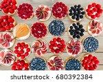 fruit and berry tarts dessert... | Shutterstock . vector #680392384