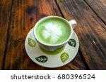 hot green tea cup on vintage... | Shutterstock . vector #680396524