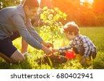boy and man both wearing shirt... | Shutterstock . vector #680402941