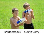kids playing with water guns at ... | Shutterstock . vector #680450899