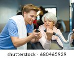 physical therapy with old lady | Shutterstock . vector #680465929